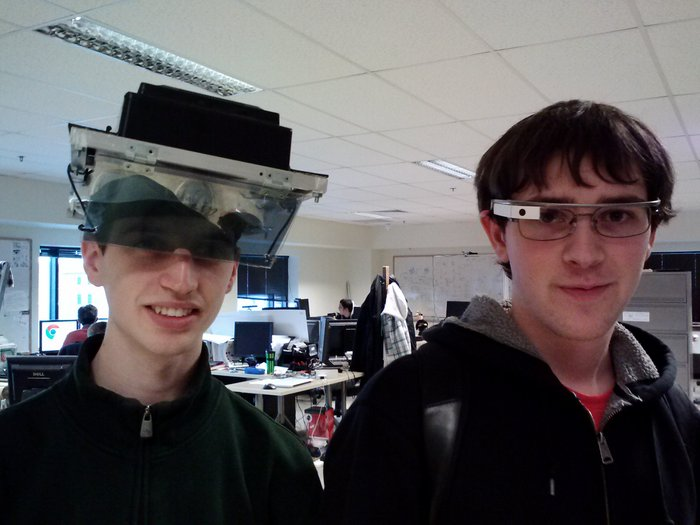 Pale-skinned people wearing Oculus Rift and Google Glass