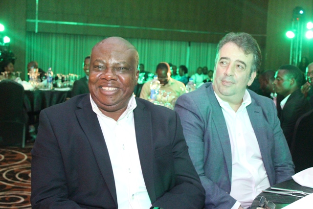 Chief Marketing Officer, Etisalat Nigeria, Francesco Angelone (R) with a guest