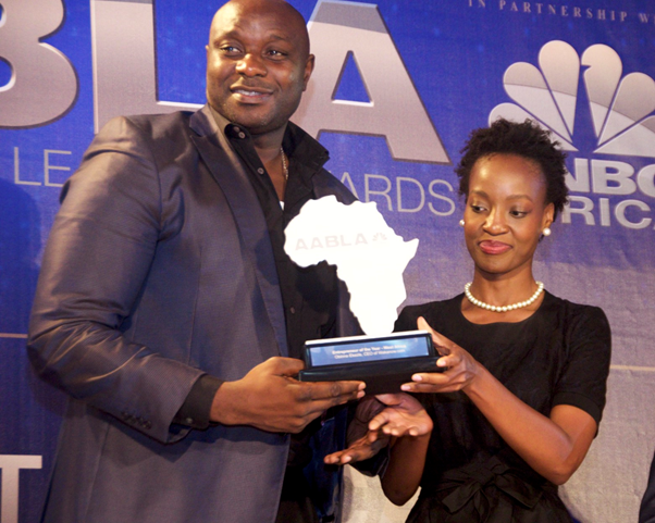 L – R Managing Director and Chief Executive Officer, Wakanow.com, Mr. Obinna Okezie receiving The Entrepreneur of the year award from Ms. Nolan Mashaba, Head, Corp Comms. ABN Group at the ALBA awards organized in partnership with CNBC Africa