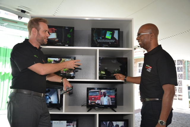 M-KOPA Solar CEO Jesse Moore with Safaricom CEO Bob Collymore
