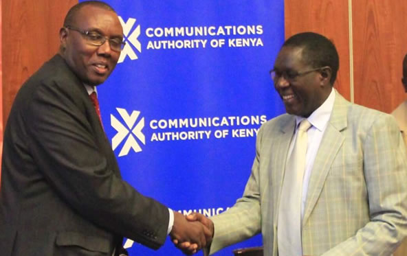 Kenya National Bureau of Statistics (KNBS) Director General Mr.Zachary Mwangi (left) and his Communications Authority of Kenya (CA) counterpart Mr.Francis Wangusi at the launch of the National ICT Survey.
