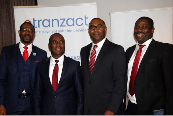 L-R: Sullivan Akala, ED, Business Development; Valentine Obi, Founder and CEO, eTranzact; Ike Eze, ED, Strategy & Corporate Development, eTranzact and Richard Omoniyi, Chief technology officer, eTranzact.