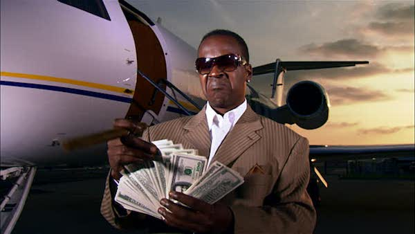 black man with money