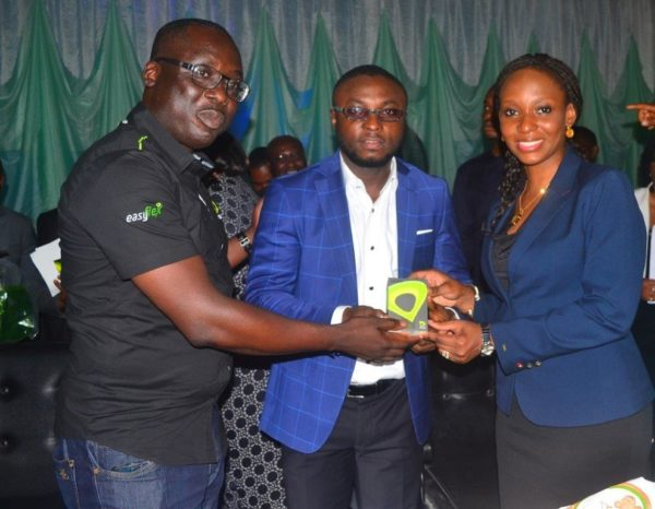 Calabar- Mohammed and Oyetola presenting a gift to Asu Okang Commissioner for Youths and Sports River State First Lady
