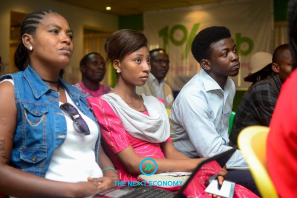 Cross section of young Nigerians listening to the opening presentation.
